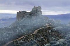Ancient castle in the mist. Avila. Stock Photo