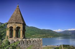 Ancient castle in the mountains over the lake. Sunny summer day stock photography