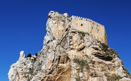 Ancient castle on a rock, mussomeli, sicily. An overall view of  the medieval fortress of mussomeli, in sicily, a famous sample of architecture of the Stock Photo