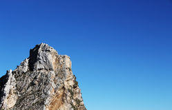 Ancient castle on a rock, space for text royalty free stock image