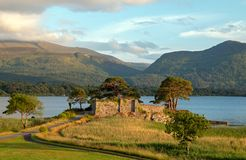 Ancient castle ruins McCarthy Mor on Lake Lough Leane at Killarney on the Ring of Kerry in Ireland. EU royalty free stock photography