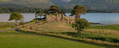 Ancient castle ruins McCarthy Mor on Lake Lough Leane at Killarney on the Ring of Kerry in Ireland. EU royalty free stock photo