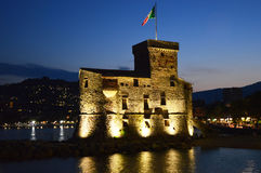 The ancient castle on the sea Castello sul Mare at night, Rapallo, Genoa Genova, Italy. royalty free stock photography