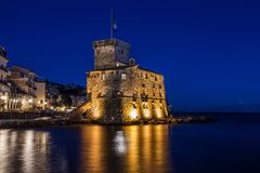 The ancient castle on the sea by night, Rapallo, Genoa Genova, Italy royalty free stock image