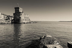 Ancient castle by the sea in Rapallo, Italy, black and white photography. Stock Images