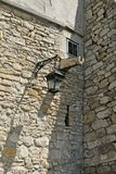 Ancient castle with street lamp, window and water pipe for the. Fragment of the ancient castle with street lamp, window and water pipe for the rain stock images