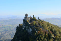 The ancient castle. On top of a mountain forested Stock Images