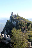 The ancient castle. On top of a mountain forested Stock Photo