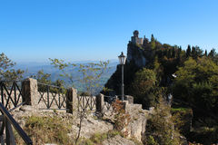 The ancient castle. On top of a mountain forested Royalty Free Stock Image