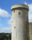 Ancient Castle Turret. An ancient  turret of a norman castle with battlements, against a bakcgound of blue sky. Chateau of Falaise, France Stock Photo