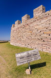 Ancient castle wall with information sign Royalty Free Stock Photo