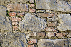 Ancient castle wall made of red bricks and large field stones Royalty Free Stock Image
