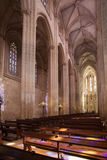 Ancient cathedral with a beautiful interior with columns, glare Royalty Free Stock Images