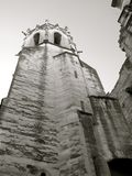 Ancient Cathedral Tower. An ancient tower reaches to the sky, alone in the town's skyline Stock Images