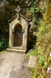 Ancient catholic shrine, Rocamadour, France. A photograph of a small old shrine along the way of the pilgrimage to the holy town of Rocamadour, the most popular Royalty Free Stock Images