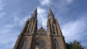 Ancient Catolic Church towers in Eindhoven timelapse with clouds on blue sky stock video
