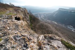 Ancient cave city in the rock in Crimea in autumn Stock Images