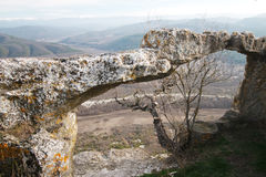 Ancient cave city in the rock in Crimea in autumn Royalty Free Stock Photos