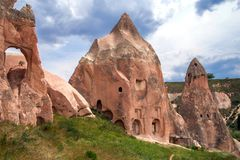 Ancient cavetown near Goreme, Cappadocia, Turkey. View to cliff dwellings royalty free stock photo