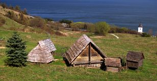 Ancient Celtic buildings. Ancient wooden buildings along shore. Celtic archaeological museum, Slovakia stock photos
