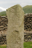 Ancient Celtic Tombstone. An ancient Celtic tombstone in an old monastery with many of the old decorations still showing. The Cross at the top was supposedly stock photography