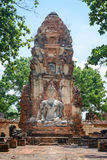 Ancient cement buddha statue in front of ruined pagoda at ancien Royalty Free Stock Photos