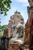 Ancient cement buddha statue on ruined ancient temple Stock Photography