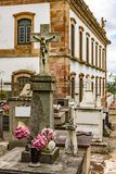Ancient cemetery next to historic church royalty free stock image