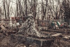 Ancient cemetery tombstones monuments of angels mysticism mystery ghost spirits bring death. Ancient cemetery mysticism mystery ghost spirits bring death Stock Image