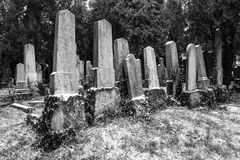 Ancient cemetery tombstones in winter Stock Photos