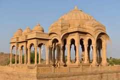 Ancient cenotaph with modern wind mills in bada baag Jaisalmer Rajasthan India Stock Photography