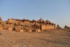 Ancient cenotaph with modern wind mills in bada baag Jaisalmer Rajasthan India Royalty Free Stock Photography