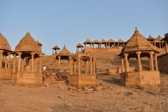 Ancient cenotaph with modern wind mills in bada baag Jaisalmer Rajasthan India Stock Images