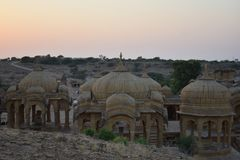 Ancient cenotaph with modern wind mills in bada baag Jaisalmer Rajasthan India Royalty Free Stock Photos