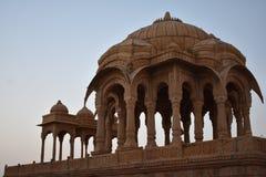 Ancient cenotaph with modern wind mills in bada baag Jaisalmer Rajasthan India Stock Photos