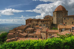 Volterra ancient center, Tuscany, Italy. View on antic stone buildings Baptistery of San Giovanni in central Tuscany village of Volterra, Italy Royalty Free Stock Images