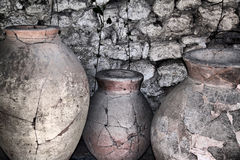 Ancient ceramic pitchers. At the wall maded in HDR Royalty Free Stock Photography