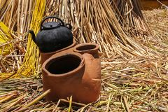 Ancient ceramic stow on floating isle on lake Titicaca stock images