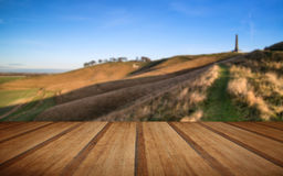 Ancient chalk white horse in landscape with wooden planks floor Royalty Free Stock Photos