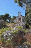 Ancient Chapel. Above the town of Hvar, along the trail to the fortress, is this ancient stone building Royalty Free Stock Images