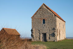 Ancient Chapel. The Chapel of Saint Peter Ad Murum in a coastal field at Bradwell, Essex, England, UK Stock Photography