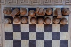 Ancient chessboard with figures. The view from the top stock image