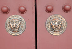 Ancient Chinese architecture copper door knocker. ,Symbol propitious and majesty stock photo