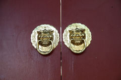 Ancient Chinese architecture copper door knocker. ,Symbol propitious and majesty royalty free stock photography