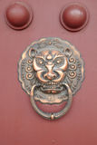 Ancient Chinese architecture copper door knocker Stock Photo