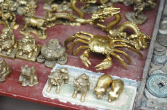 Ancient chinese artifacts. Closeup of gold colored Chinese  ornaments and money Royalty Free Stock Photos