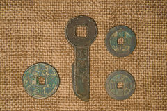 Ancient Chinese bronze coins on old cloth Royalty Free Stock Photography