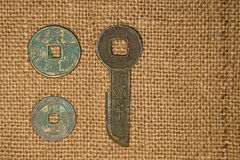 Ancient Chinese bronze coins on old cloth Stock Images