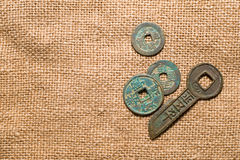 Ancient Chinese bronze coins on old cloth Stock Image