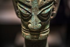 Ancient Chinese Bronze Mask from Sanxingdui Archaeological site Beijing National Museum, February 21, 2019 royalty free stock images